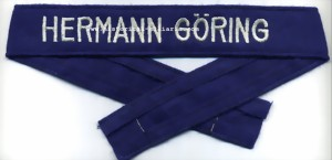 HERMANN G�ring machine-embroidered cuff band on blue fabric for Mannschaften / Enlisted Men / da truppa